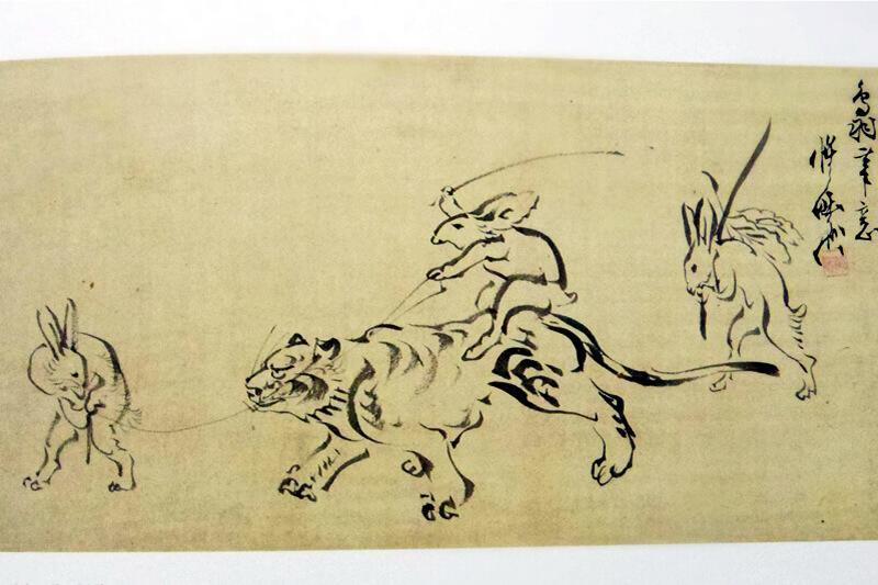 鳥獣戯画を思わせる作風「虎を送り出す兎」(購入の図録より)